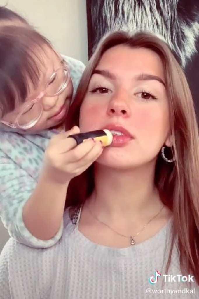 Worthy applying balm on Kalista's lips