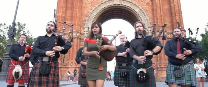 The Snake Charmer playing Amazing Grace with the City of Barcelona Pipe Band