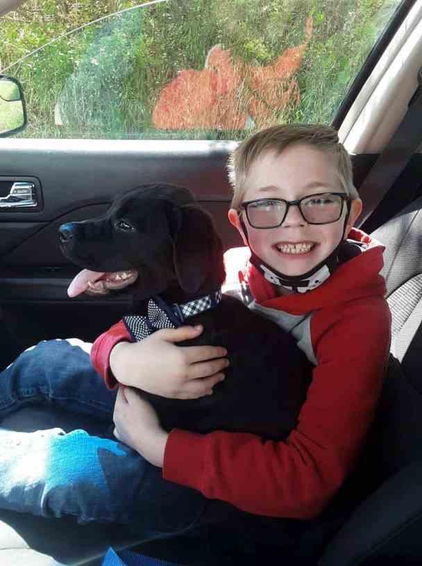 Bryson Kliemann and his dog Bruce