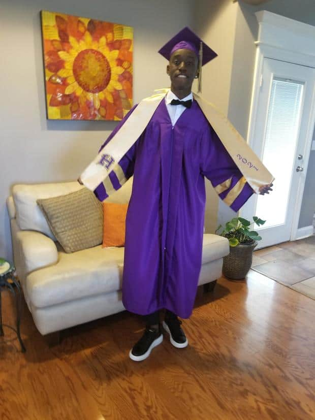 Daverius Peters wearing his graduation cap and gown