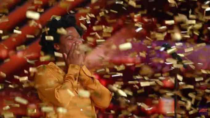 Gold confetti raining down on Jimmie Herrod