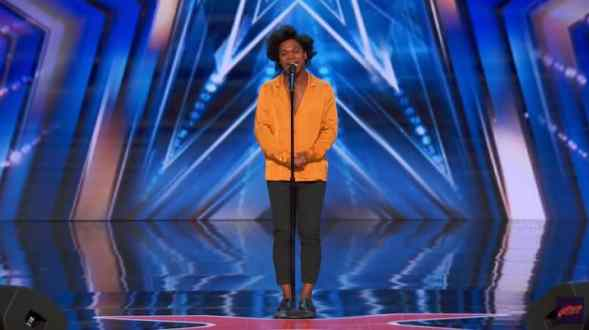 Jimmie Herrod standing on the America's Got Talent stage