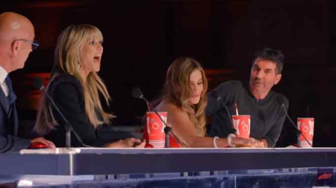 Sofia Vergara pushes the golden buzzer as Howie Mandel, Heidi Klum, and Simon Cowell excitedly look on