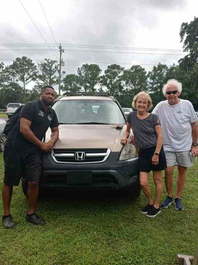 Eliot Middleton with a community member he gifted with a repaired car