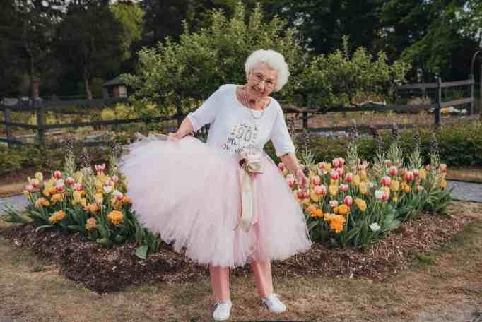 A grandma wearing a pink tutu