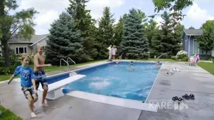 Children swimming in Keith Davison's backyard pool