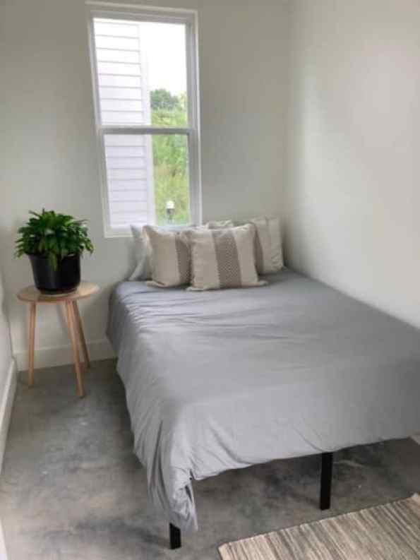 A bedroom inside a tiny home