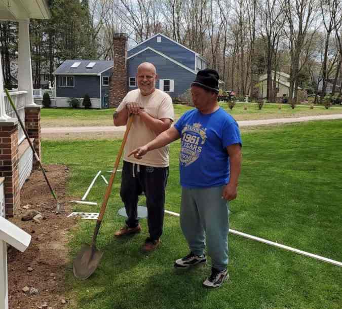 Scott helps Robert build his home