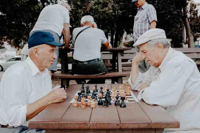 Two senior men playing chess
