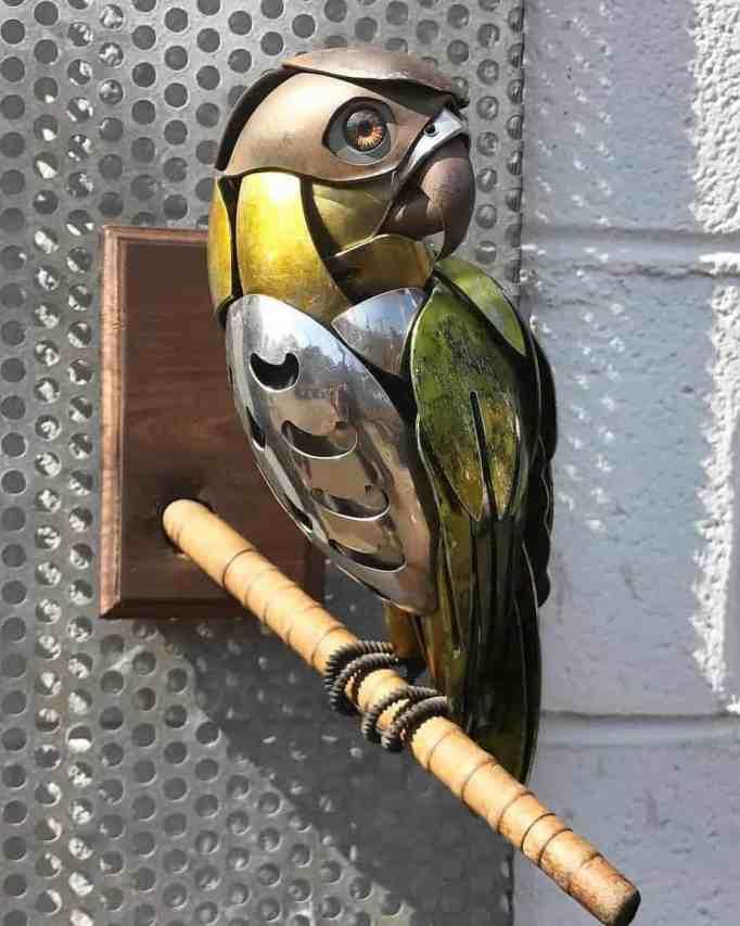 A parrot sculpture made from metal