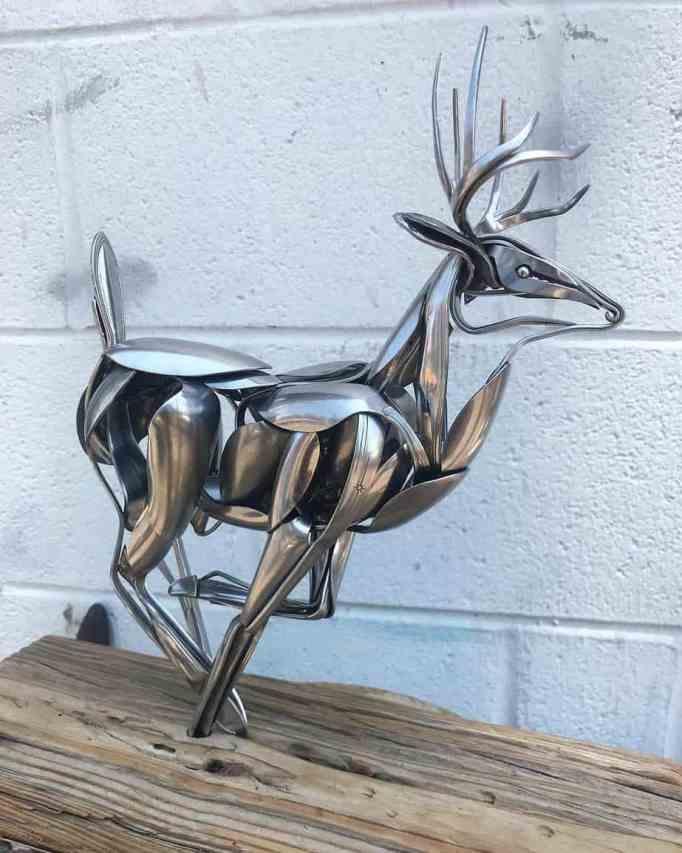 A deer sculpture made from metal