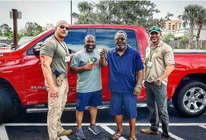 Patrol Lieutenant Eric Fields with three other men