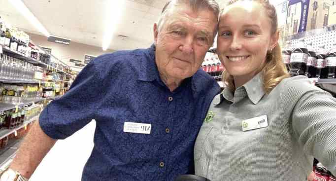 Riley Day with an elderly Woolworths customer