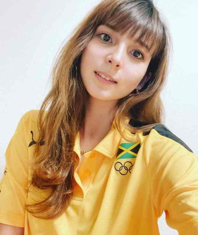 Trijana Stojkovic wearing the Jamaican Olympic shirt that Hansle gave her