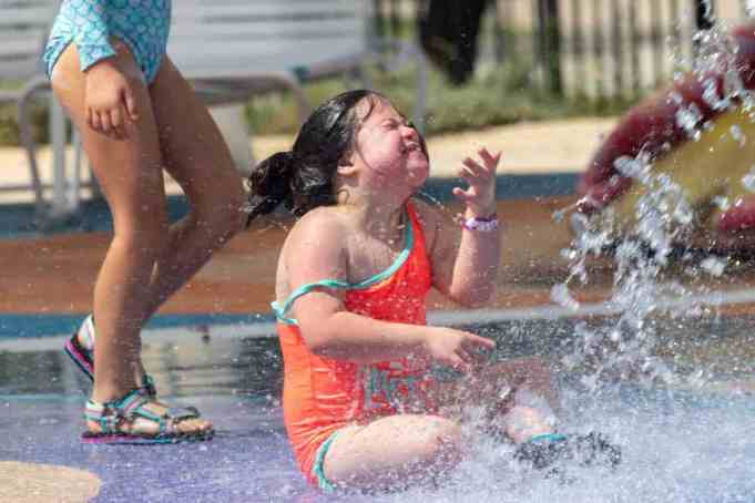 Girl with down syndrome having fun with water