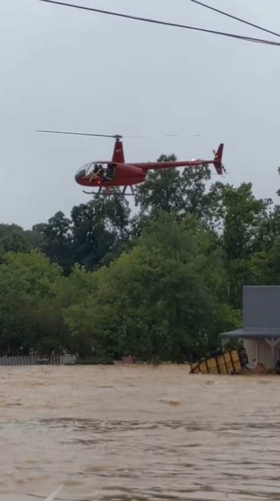 A helicopter hovering over the flood in Waverly, Tennessee