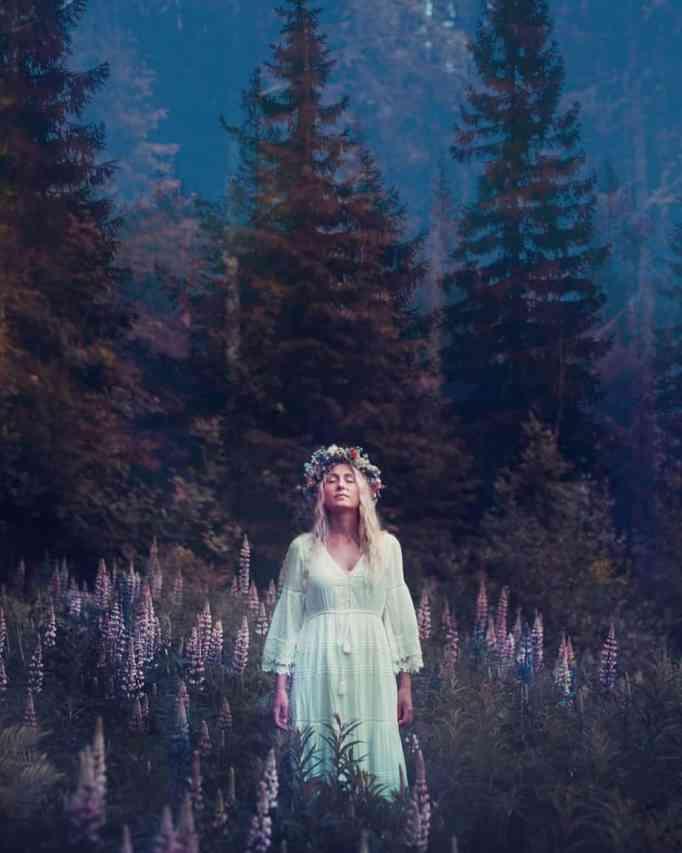Jonna Jinton wearing a white dress and flower crown