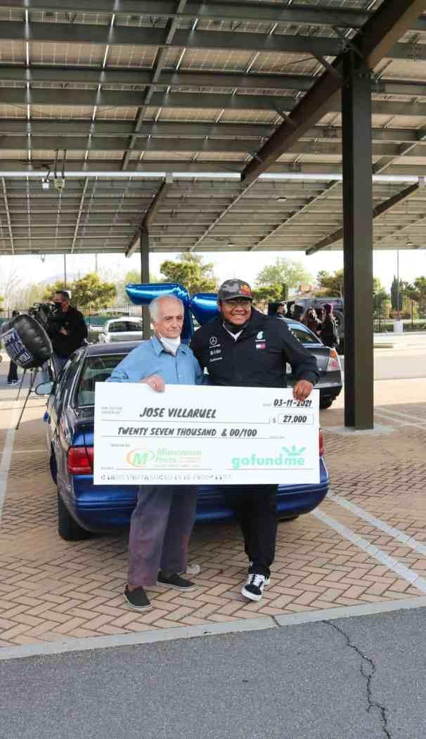 Jose Villaruel and Steven Nava holding a giant $27,000 from GoFundMe