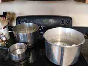 pots on stove ready to can