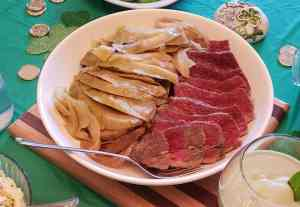 Corned beef and cabbage on white plate