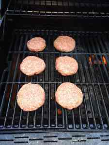 Low Carb BBQ Cheddar Burgers raw on the grill