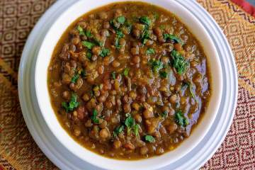 Sabut Masoor Dal is a delicious & wholesome Indian stew made from whole brown lentils cooked in a Punjabi onion tomato gravy. It is a healthy dish that goes really well with Rice or Rotis.