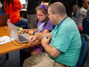parent and child participating in WordCamp Jax