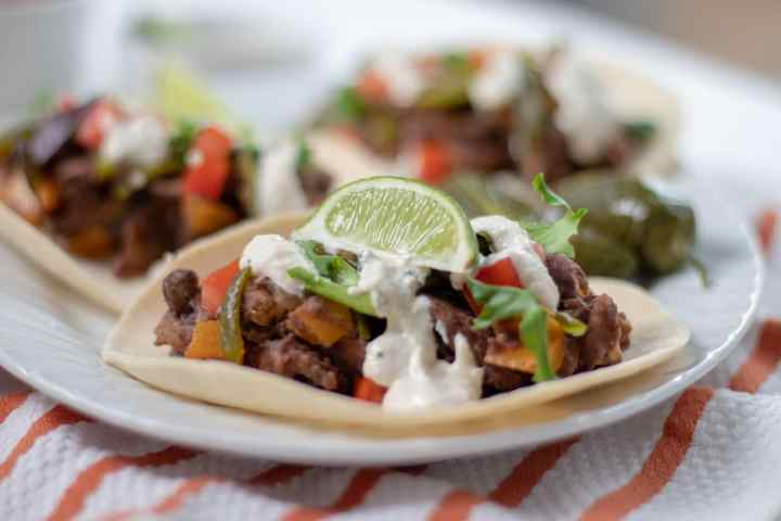 Refried Black Bean and Tempeh Tacos with Creamy Lime Dressing