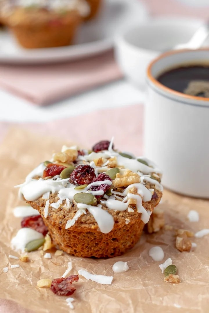 Loaded Breakfast Muffin next to a cup of coffee