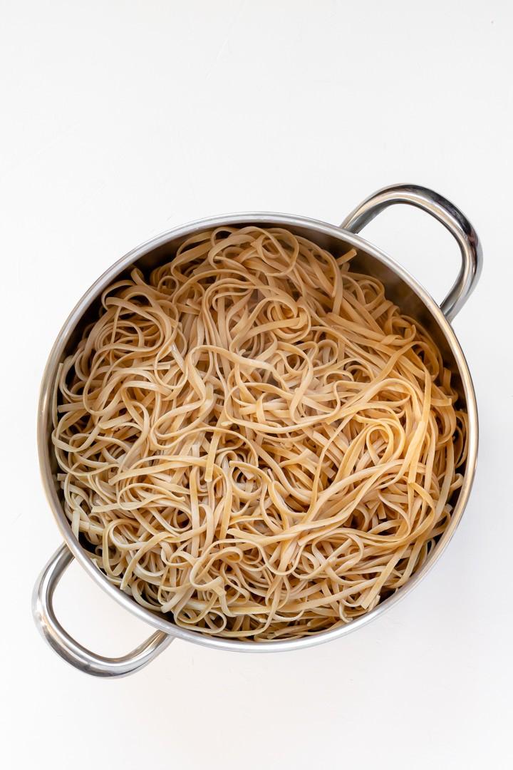 a large pot of pasta noodles