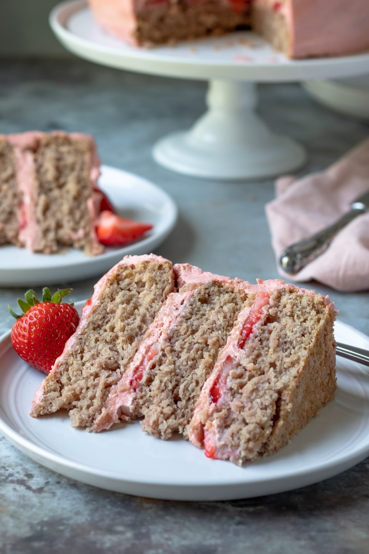 a slice of vegan strawberry cake on a plate