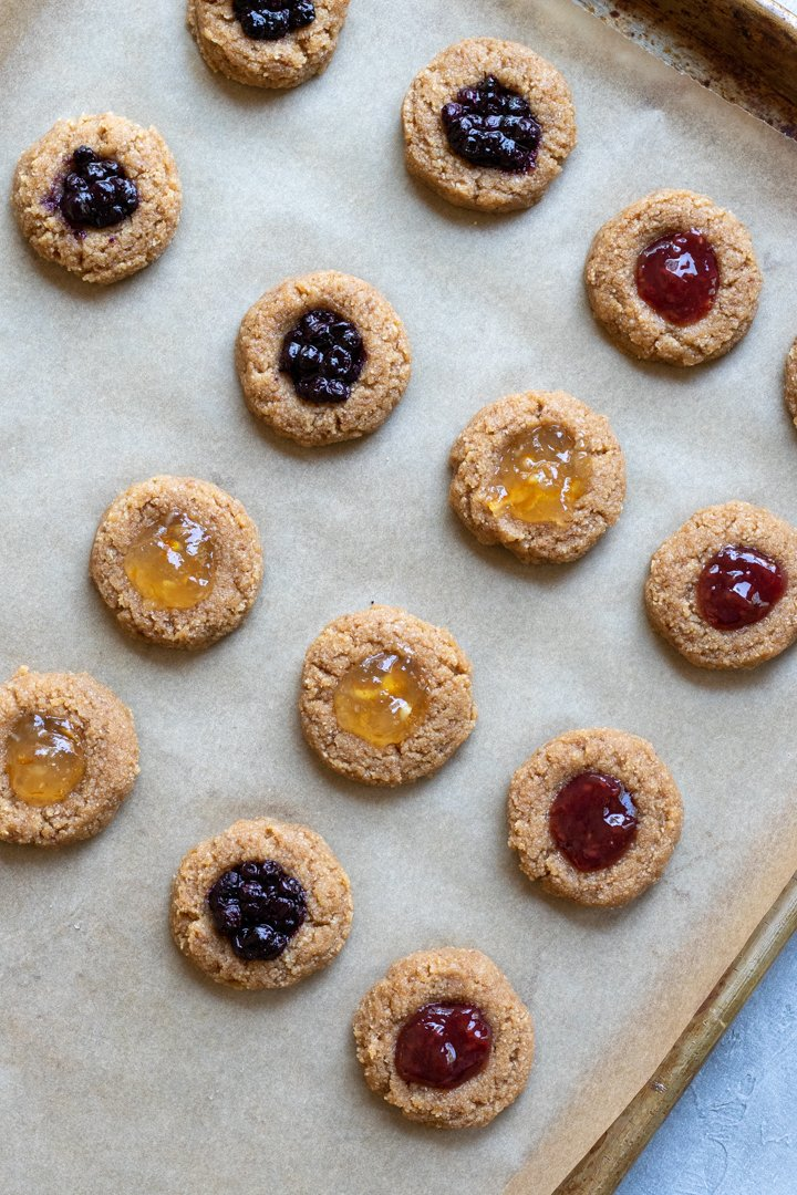 thumbprint cookies filled with jelly and ready to be bakes