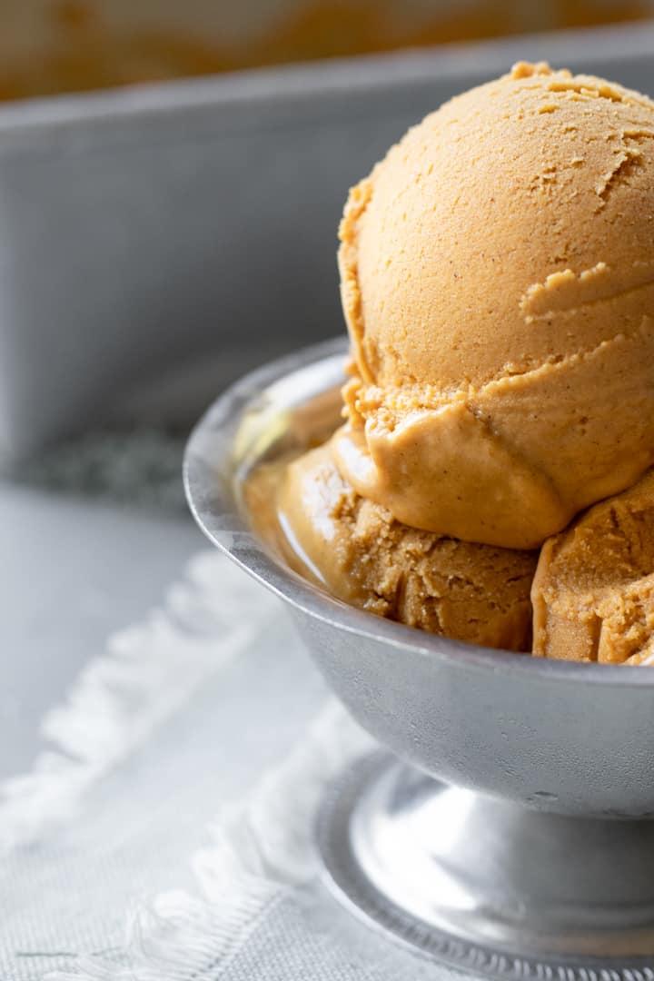 a close up of pumpkin oat ice cream in a dish