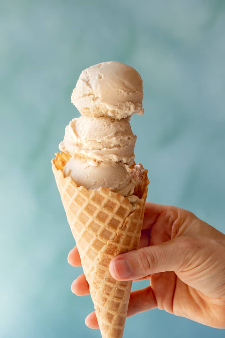 three scoops of Vegan Vanilla-Maple Ice Cream in a waffle cone