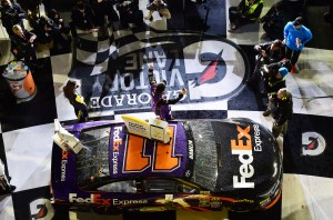 DAYTONA BEACH, FL - FEBRUARY 13:  Denny Hamlin, driver of the #11 FedEx Express Toyota, celebrates in Victory Lane after winning the NASCAR Sprint Cup Series Sprint Unlimited at Daytona International Speedway on February 13, 2016 in Daytona Beach, Florida.  (Photo by Jared C. Tilton/Getty Images)