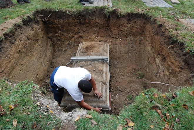 Racine County officials working with counterparts from the National Center for Missing and Exploited Children on Wednesday exhumed the grave of an unidentified woman who was murdered in 1999. Officials are looking for new clues to solve the case.