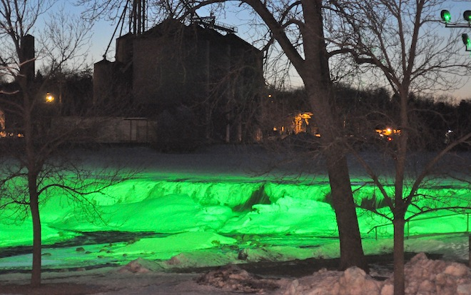 The White River dam at Echo Lake takes on an other-worldly glow on Feb. 27 in a preview of a new lighting system that will illuminate the dam in a variety of colors. The project was financed by Bobbie Wagner as a gift to the community and a tribute to her late husband, Dick, who conceived the idea. (Photo by Ed Nadolski)
