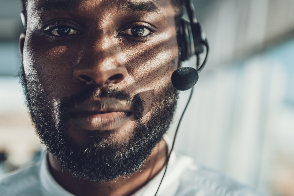 Front view portrait of operator man with headset