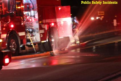 Fire engines and equipment filled the street while firefighters battled the blaze. Robert Carter photo