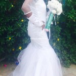 Bride poses with hand on her waist