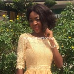 Bride happily and stylishly shows off her wedding ring
