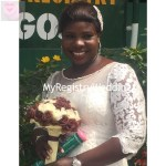 Happy Bride shows off her marriage certificate