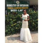 Bride shows off her certificate