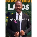 Groom stylishly shows off his ring as he pose