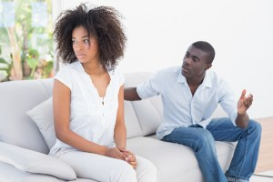 Husband correcting his wife