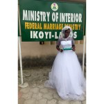 Bride shows off her marriage certificate