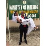 Bride is excited as groom carries her