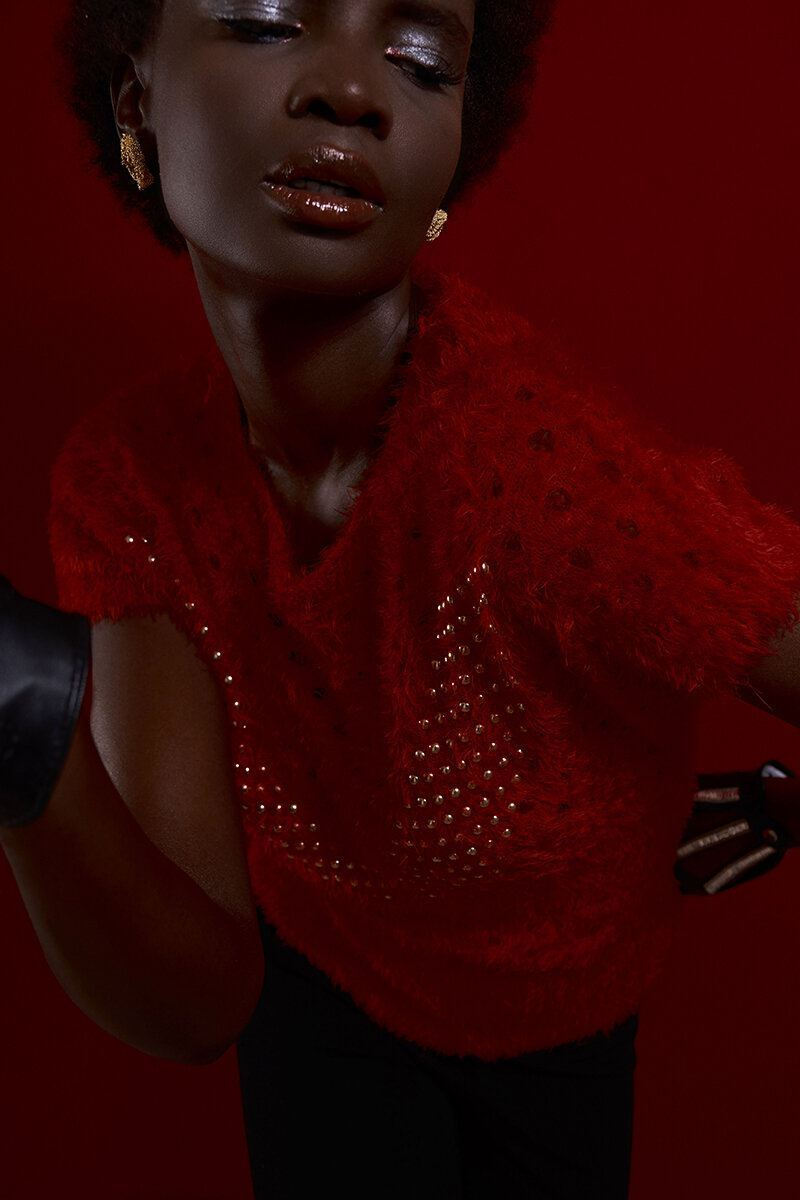 Daniel Garo x Put on your dancing shoes Black woman with golr earrings by Myriam Moreno