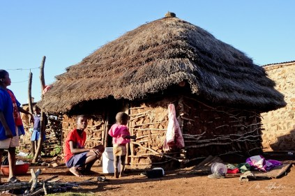 a house in a local village in the Shewula mountain camp in Swaziland Eswatini with kids playing round