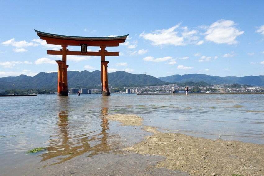 Itsukushima shrine Miyajima island at low tide . Japan